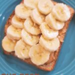 Sliced bananas on peanut butter toast, my perfect snack!